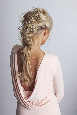 Messy french plait with flowers for the festival hair look