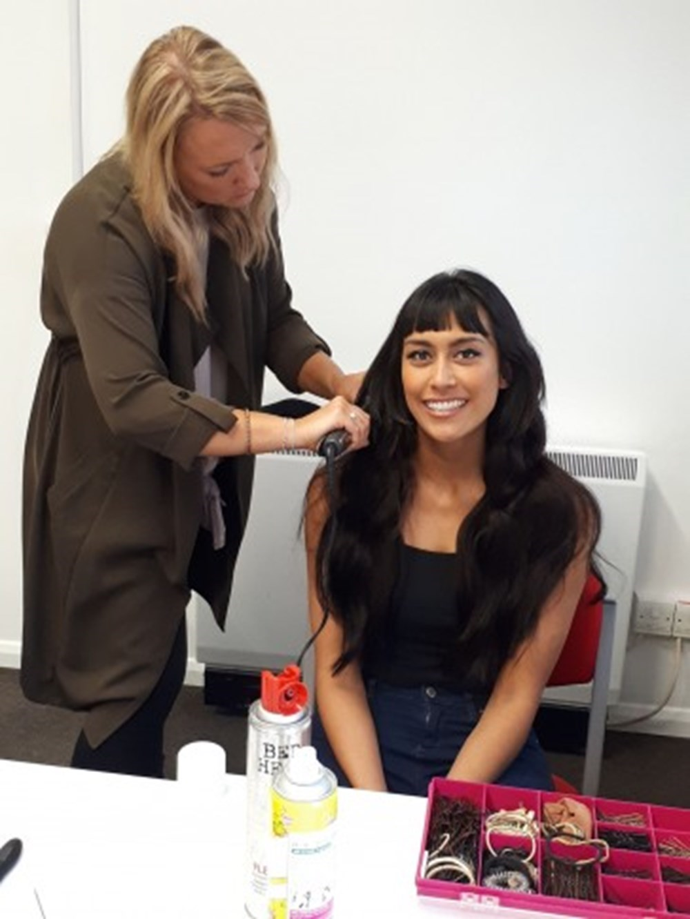Makeup Artist, Holly Edwards putting Hair Extensions in